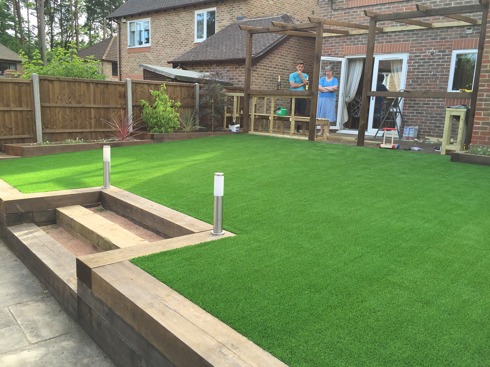 artificial lawn and sleeper flower bed